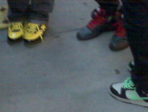 Bright-colored shoes on Kid Cudi fans